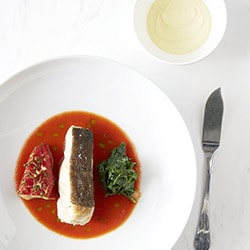 Roasted cod fish, stuffed red peppers with brandade and garlic tomato juice - Restaurant les Remparts